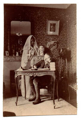 1900/10s GHOST / Spirit / Phantom girl behind desk PHOTO Photomontage Surrealism