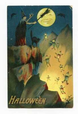 Vintage Halloween Card.....Witch & Black Cat Throwing Pumpkin Heads Off Cliff
