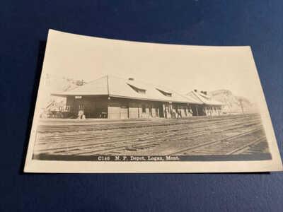 1900's RPPC Postcard Train Railroad Northern Pacific Depot Logan Montana
