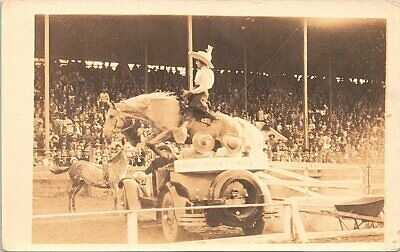 RPPC Rodeo Scene Woman Cowgirl Jumping over Buick Nesbit Motor Co. 1920s