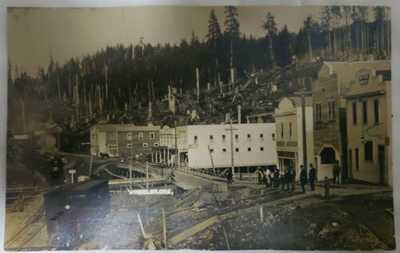 1916 Wheeler Oregon RPPC timber Town scene with trains and new roads being built