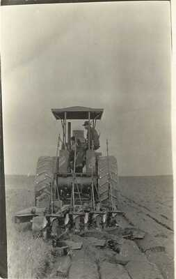c1907 RPPC Man on Steam Engine Tractor Farm Equipment Breaking Sod Unknown US