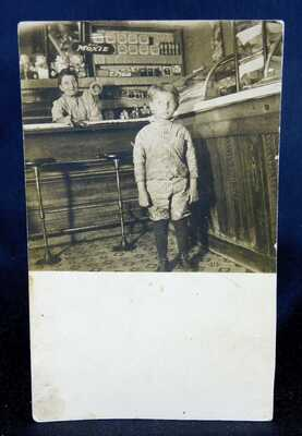 Drink Moxie - RPPC - Soda Soft Drink - Boy in a Store with Moxie Sign