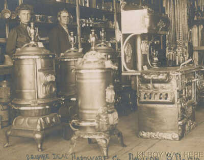 1908 RPPC Square Deal Hardware Co Davison SD Mr Smith & Wife Cast Stoves Superb!