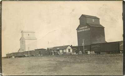 RPPC Postcard; Girvin Saskatchewan Depot RR Cars & Grain Elevators Unposted
