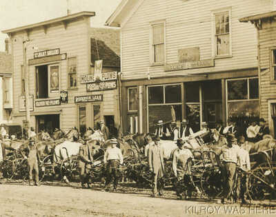 1913 RPPC Main St Farm Plows Rock Island Moline Joliet Oliver Rumely Hamm Beer