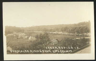 1910S RPPC, AVIATOR PARMALEE RISING FROM EXPO GROUNDS, CEDAR RAPIDS, IA.