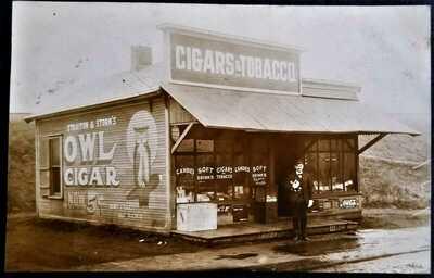 Real Photo RPPC: Man Outside Cigar & Tobacco Shop, Coca Cola Sign. Pre-1920.