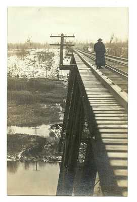 OLD MANISTEE MI RPPC - ARTISTIC IMAGE TAKEN BY JENNIE SMITH - MAN ON TRESTLE
