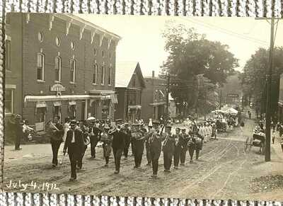 Waterbury, Vt. Dated 1912 Real Photo Showing 4th of July Parade up Main Street