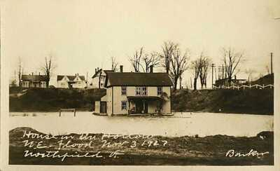 Northfield, Vt. A 1927, RP of a Flood Scene of a House in A Hollow in Northfield