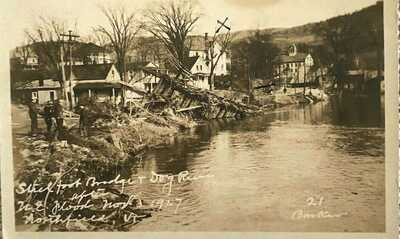 Northfield, Vt. A 1927, RP of a Flood Scene of a Stick Bridge in Northfield.