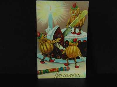 Vintage Embossed Halloween Postcard pumpkins cutting cake.