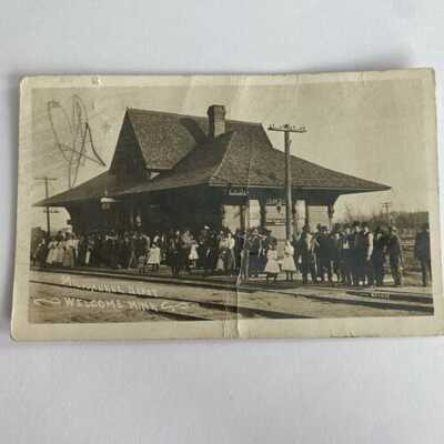 RPPC Milwaukee Train Depot - Welcome MINN Wells Fargo Top Hat AZO Postcard 1910s