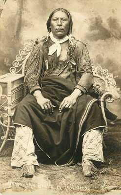 RPPC Postcard Comanche Indian Brave in Full Dress, Lawton OK, Bates Portrait