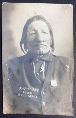 Postmarked 1910 RPPC PHOTO OF FASTWALKER NOTED SIOUX SCOUT Native American