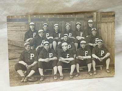 1900's Baseball Team In Uniform Men Seated in Wooden Dugout RPPC Great Image!