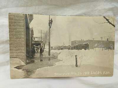 1912 Lucas Kansas Main Street after Snow Storm Hotel Arcade RPPC