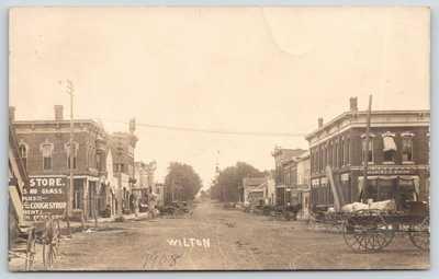 Wilton Iowa~Main Street~Drug Store~DT Voorhees Hotel~Charles C Bacon~1908 RPPC