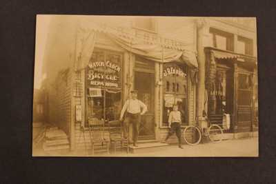 1909 RPPC REAL PHOTO POSTCARD WATCH CLOCK BICYCLE SHOP MARYSVILLE OHIO