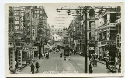 "Hong Kong b/w PPC ""Des-Voeux Road H.K."" to Switzerland 5.3.1956"