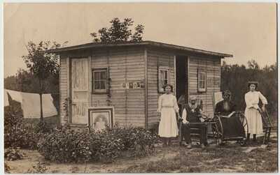 1910 ONE ROOM SHACK VIOLIN & WHEELCHAIR PHOTO POSTCARD RPPC Edmore MI DELTIOLOGY