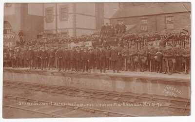 STRIKE SCENES LANCASHIRE FUSILIERS LEAVING MID RHONDDA MCH 31.1911
