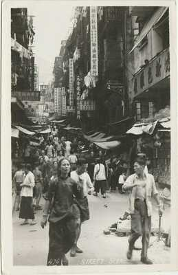 1953 HONG KONG Real photo postcard STREET SCENE Central shops RPPC 25c stamp
