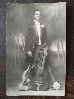 RPPC - African American Man w/ 2 Harp Guitars & Small Banjo - 1904-18