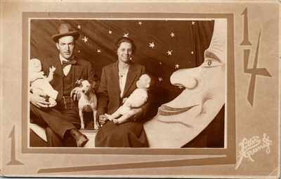 RPPC~PAPER MOON SOUVENIR~COUPLE W/ DOG & DOLLS~ARCADE STUDIO PROP~BOOTH PHOTOA38