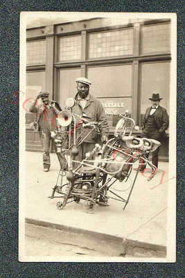 AMAZING BLACK ONE MAN BAND STREET PERFORMER  -  circa 1920 rppc Photo GRADE 5